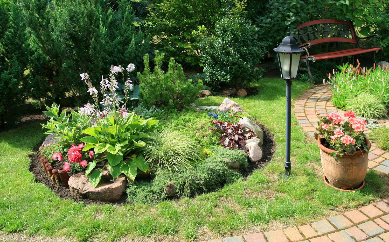 Как сделать горку на садовом участке своими руками